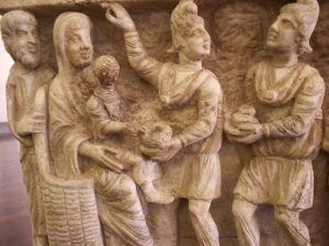 Magi bring gifts to the baby Jesus in one of the earliest known depictions. (3rd Century Sarcophagus, Vatican Museums, Italy)